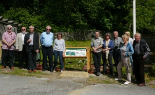 Group photo: Immediately left of the board are Trevor Beattie, Robert Cheesman (Chairman of Friends of Lewes) and Bridget Millmore; the Ranger Mark Hayward is immediately to the right