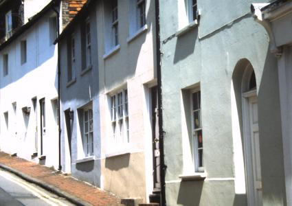 Painted rendered house fronts on St Nicholas Lane, Lewes